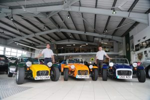 Oakmere Motor Group Jonathan Jarratt (l) with three of his Caterham Sevens and Sales Manager Steve Jeavons