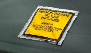 Parking ticket stuck on car windscreen a penalty or fine