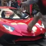 Red Lamborghini Used As A Trampoline